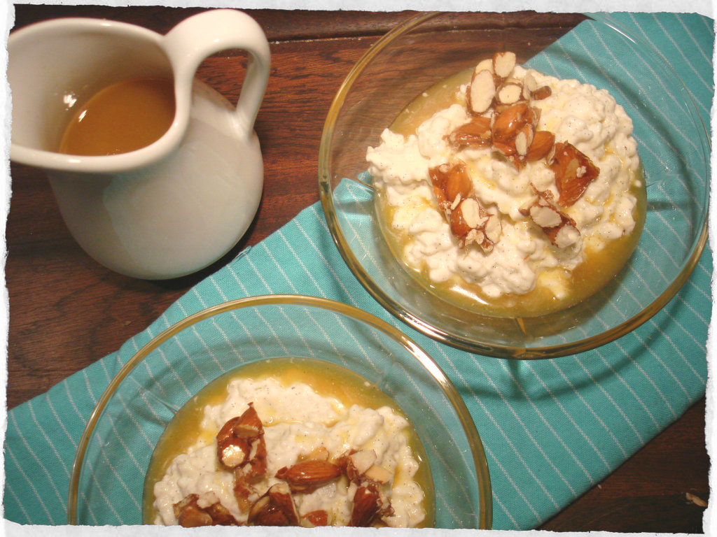 Rice pudding dessert with orange sauce
