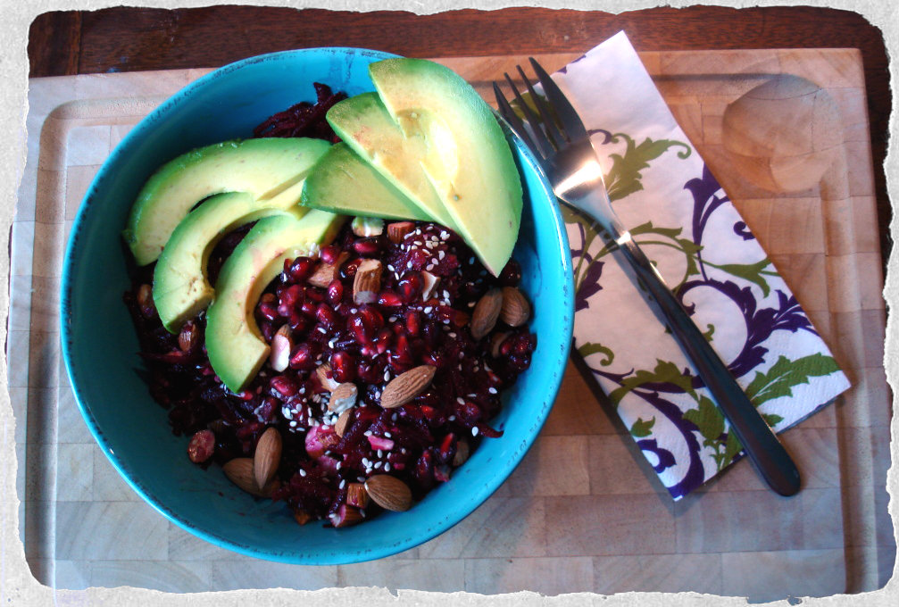 Beetroot salad with avocado, pomegranates and almonds