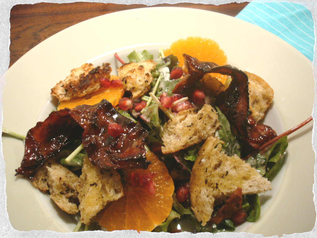 Candied bacon salad with pomegranates, clementines and croutons