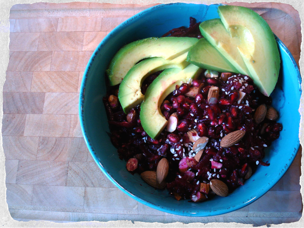 homemade salad with beetroot, almonds, avocado and pomegranates