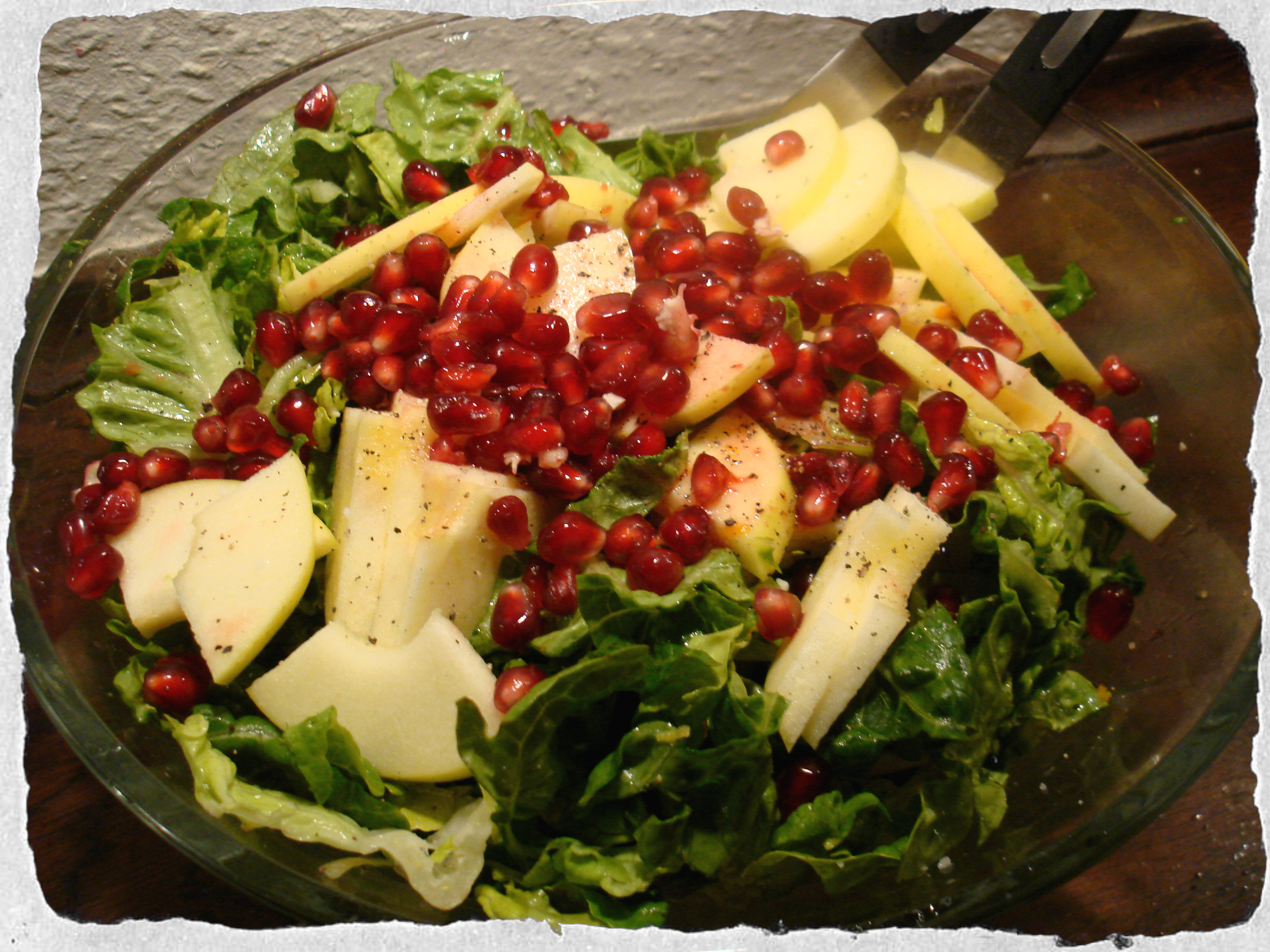 February salad with apples and pomegranate seeds. Citrus dressing
