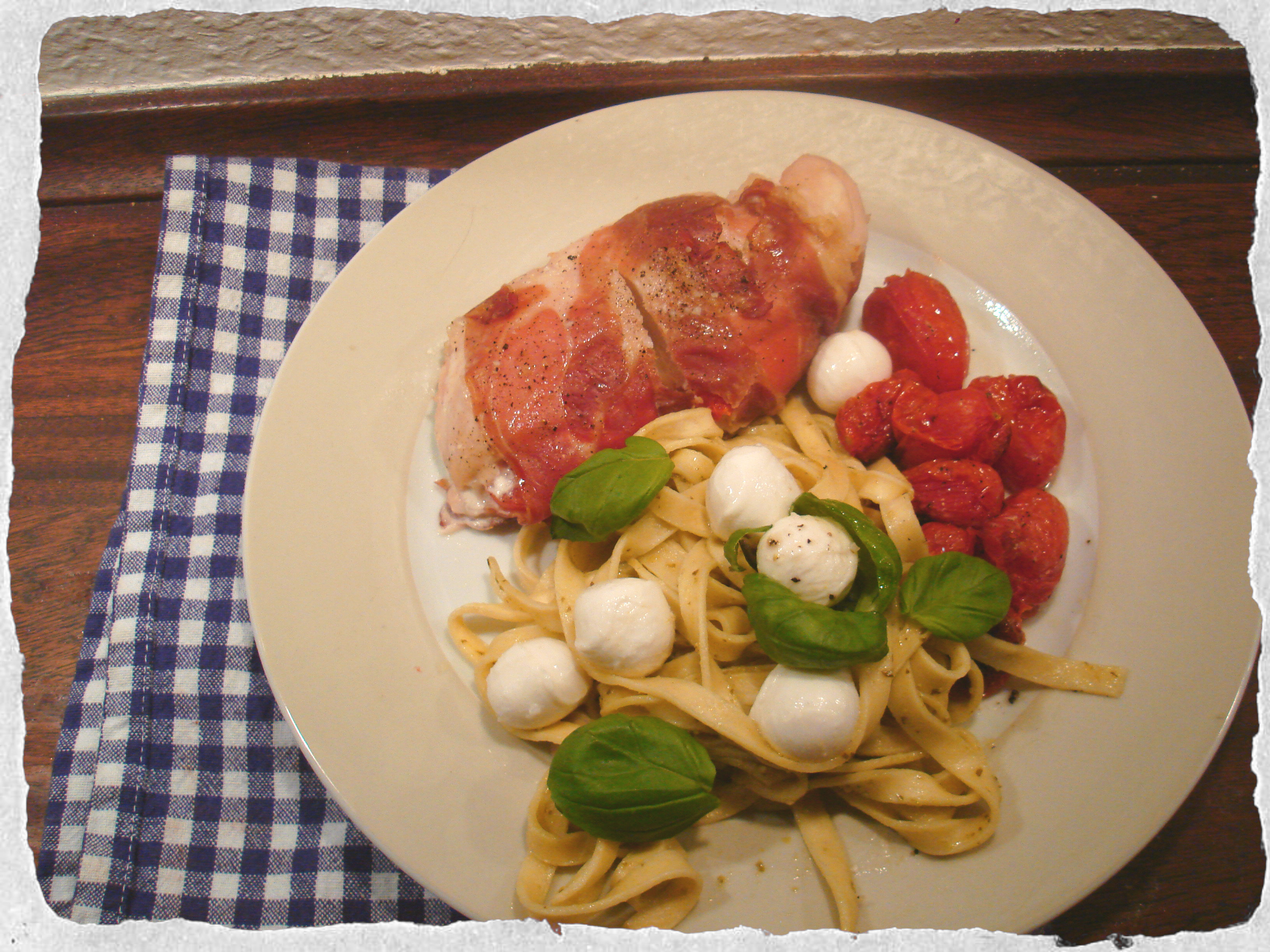 Stuffed chicken breast, pesto pasta and roasted tomatoes